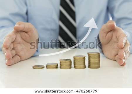 Stack coins in form of uptrend graph with investment adviser.  Financial planning and investment growth concept.