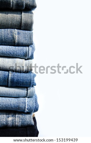 Stack jeans on white background. - stock photo
