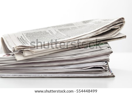 Stack newspapers on table
