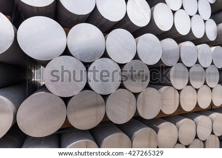 Stack of aluminium billets - stock photo