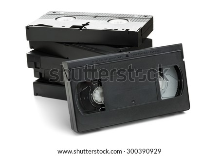 Stack of analog video home system (VHS) tape over white background