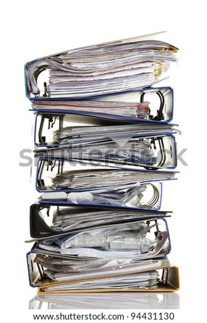 Stack of archive folders  ( ring binders ) over white background - stock photo