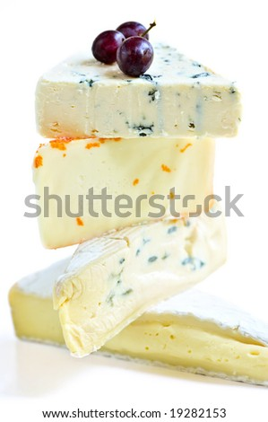 Stack of assorted cheeses isolated on white background - stock photo