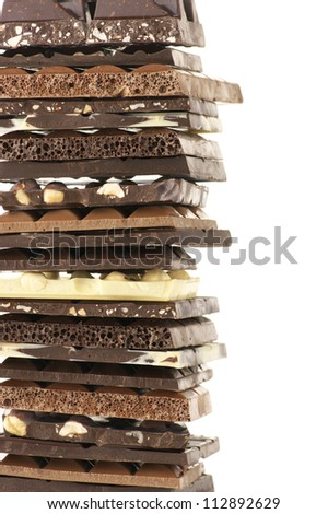 Stack of assorted chocolate on white background.. - stock photo