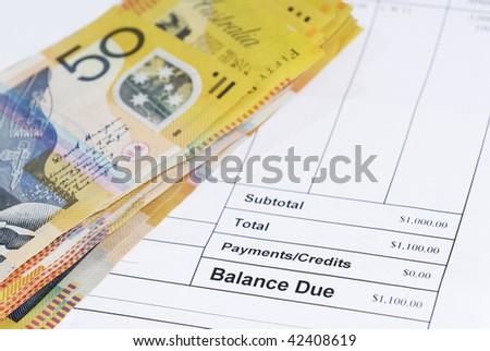 Stack of Australian fifty dollar bills on accounts notice. - stock photo