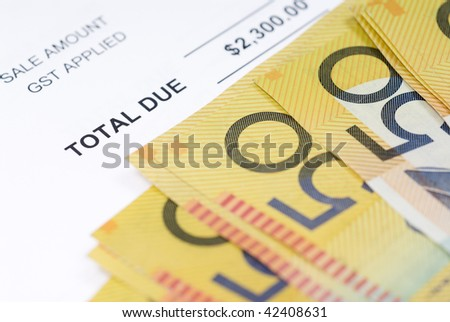 Stack of Australian fifty dollar bills on accounts notice. - stock photo