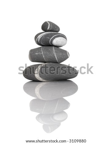 Stack of balanced stones on a white background - stock photo