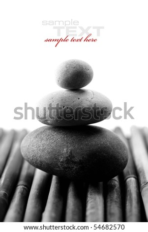 stack of balanced zen stones (with sample text) - stock photo