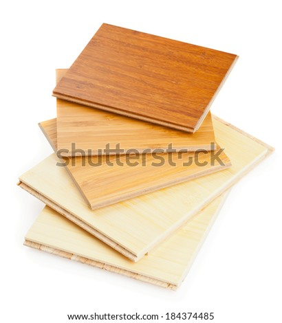 Stack of bamboo laminate flooring samples on white background - stock photo