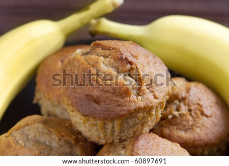 stack of banana muffins on a black plate closeup - stock photo