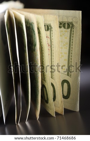Stack of banknotes isolated on the black background.