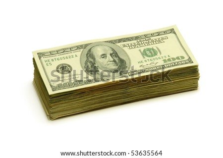 Stack of $100 banknotes on a white surface - stock photo