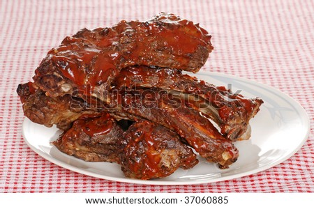 Stack of barbecue beef spare ribs with sauce