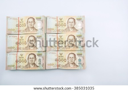 stack of 1000 bath Thai money : Thailand Currency 1000 Bath, BankNotes isolated on white background.    - stock photo