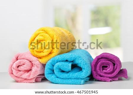 Stack of bath towels on white desk closeup