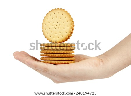Stack of biscuits in woman hand isolated on white - stock photo