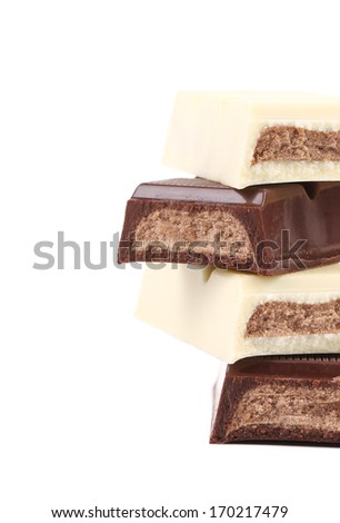 Stack of black and white chocolate bar. White background.
