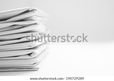 Stack Of Black And White Newspaper Background - stock photo
