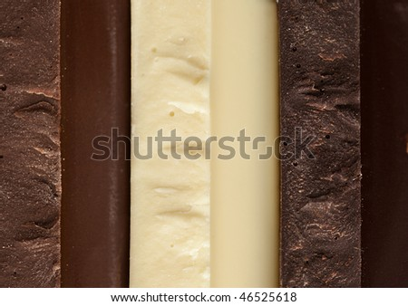 Stack of Black, Brown and White Chocolate isolated on white background