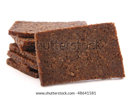 Stack of black dark bread loafs called pumprnickel - specific germa healthy whole corn read - stock photo