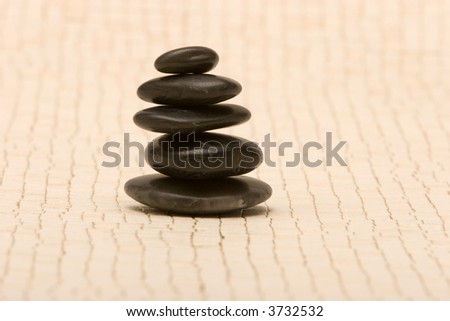 Stack of black massage stones