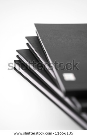 Stack of black notebooks close up