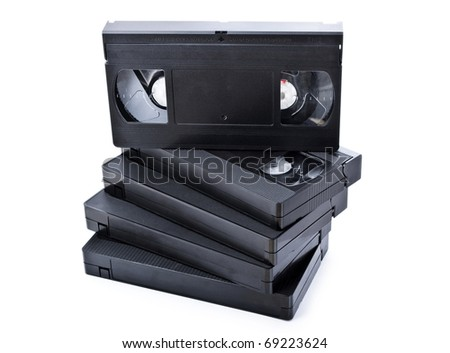 Stack of black old video cassettes isolated on white background - stock photo