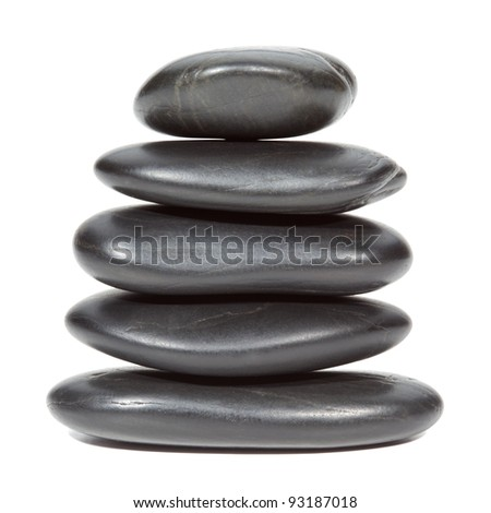 Stack of black stones balancing , isolated on the white background, clipping path included. - stock photo