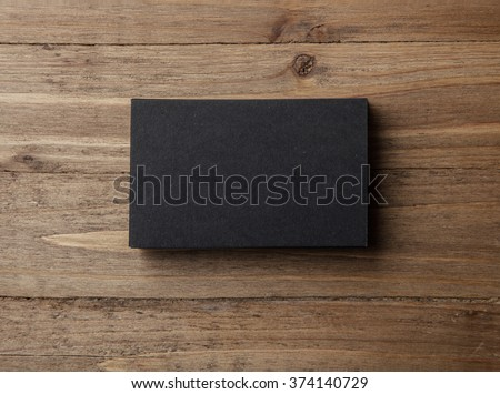 Stack of blank black business cards on wooden background Horizontal - stock photo