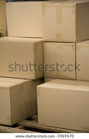 Stack of Blank Boxes in a Warehouse