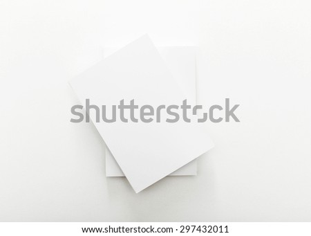Stack of blank business card on white background. - stock photo