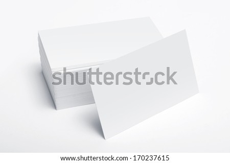 Stack of blank business cards isolated on white background - stock photo