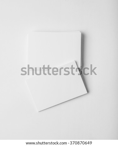 Stack of blank business cards on white background with soft shadows. Vertical - stock photo