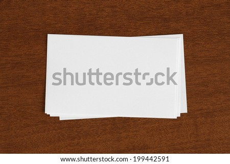 Stack of Blank Cards  on Wood Desk - stock photo