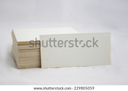 Stack of blank, empty business card on white background. - stock photo