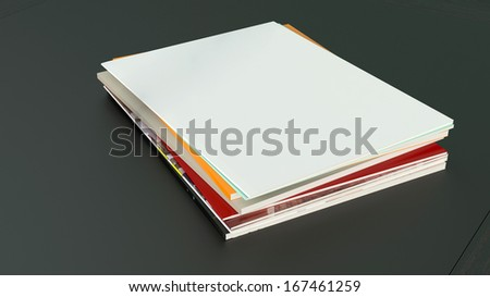 Stack of blank magazines ot the black table top - stock photo