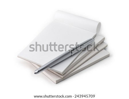 Stack of blank memo pads in real use condition, with a silver pen, isolated on white.  - stock photo