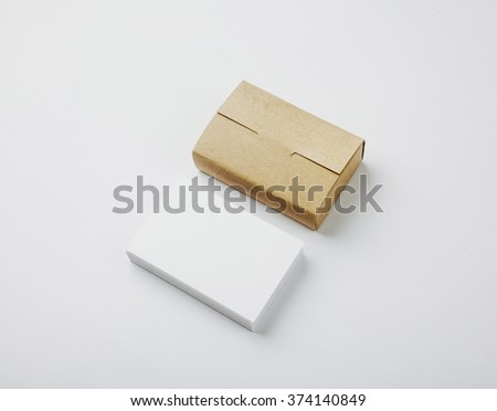 Stack of blank White business cards and craft Cards box on white background  - stock photo