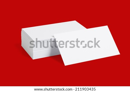 Stack Of Blank White Businesscards On Red Background