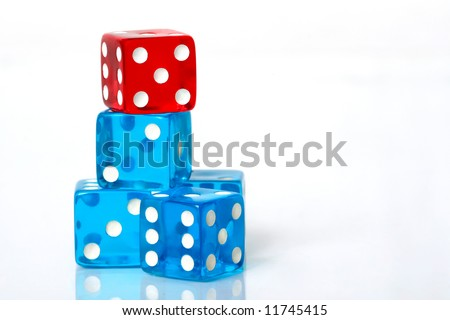 Stack of blue and red dice on a white background - stock photo