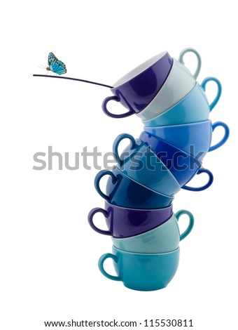 Stack of blue Coffee Cups whit Butterfly isolated on white - stock photo