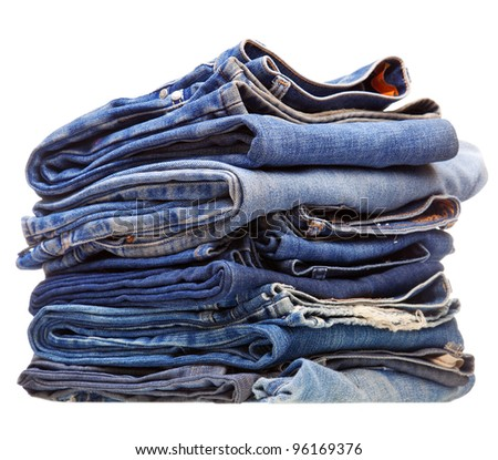stack of blue denim jeans on white background - stock photo