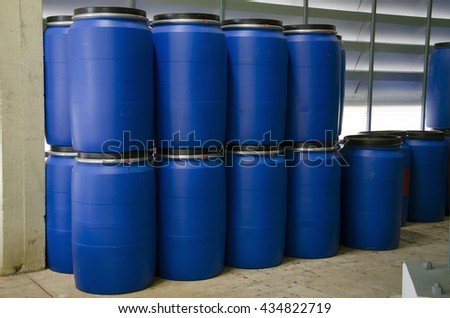 stack of blue gallons at industry - stock photo