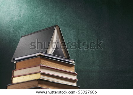 stack of book in front of board - stock photo