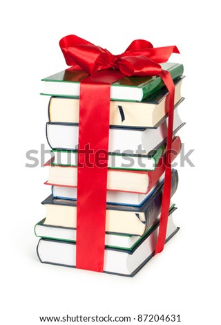 stack of book with ribbon like a gift isolated on white - stock photo