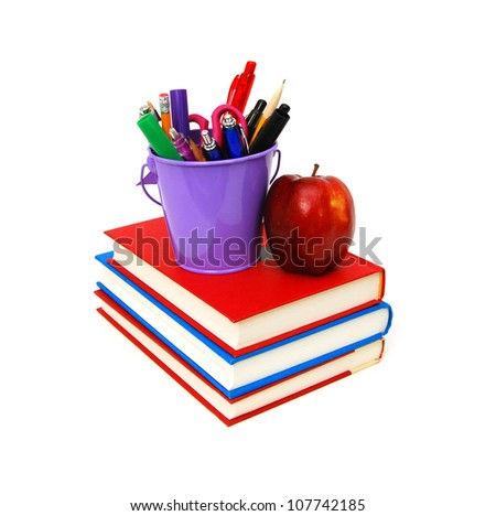 Stack of books and apple isolated on white background