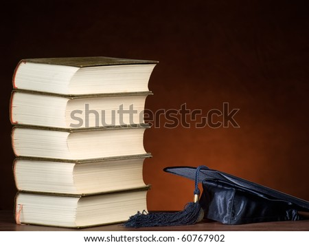 Stack of books and graduation cap, for various education,graduation or knowledge themes
