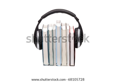 Stack of books and headphones isolated on white background