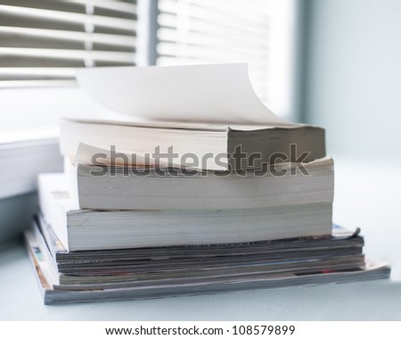 Stack of books and magazines - stock photo