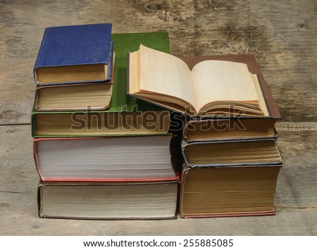 stack of books and open book - stock photo